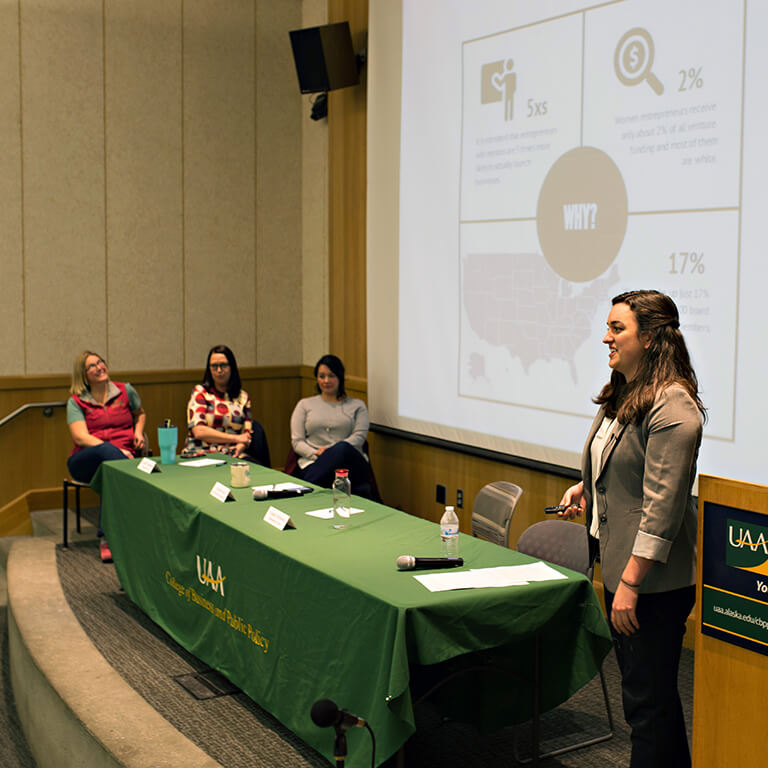 Johnson (right) presents her findings during the Women Entrepreneurship Week celebration event on Oct. 16.