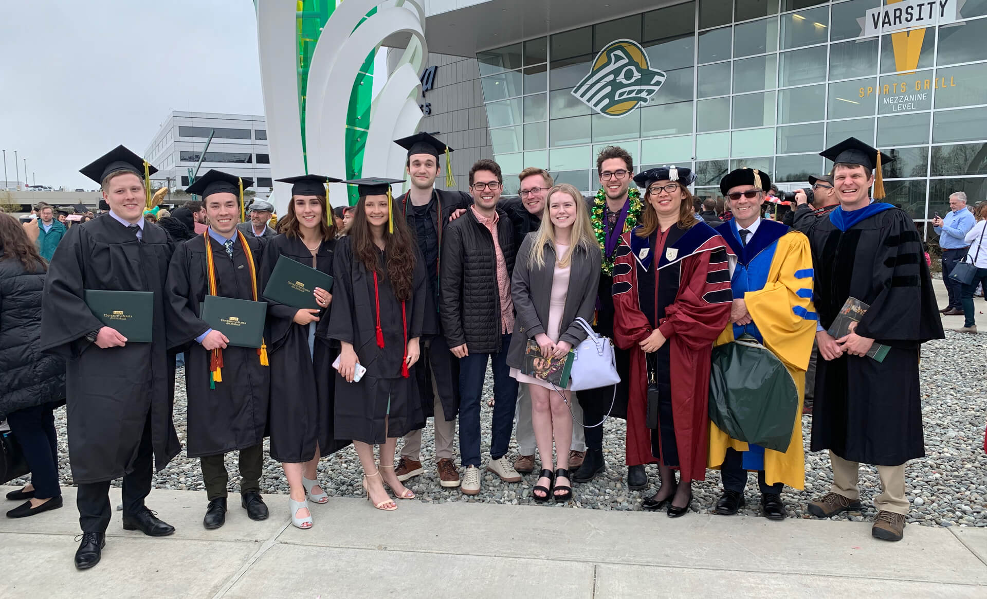Pictured left to right: Paul Melin, Alexander Jackstadt, Morgan Rowe, Heather Jesse, Gavin Triplett, Nathanial Watanabe, Christian Bullard, Clare Baldwin, Joshua Watanabe, Associate Professor Angie Zheng, Professor Paul Johnson, and Associate Professor Lance Howe.